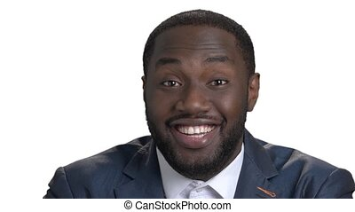 Close up portrait of laughing black man.