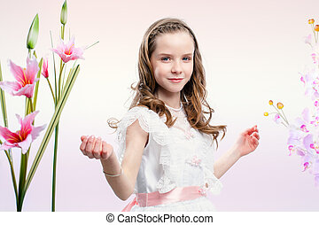 Little bride in white dress with flowers.