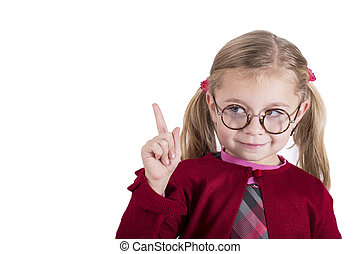 Close-up portrait of little girl wearing glasses