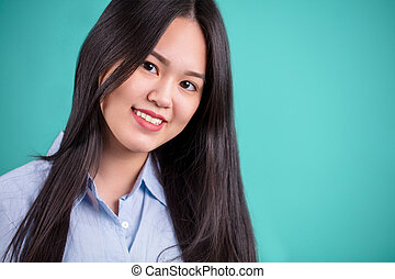 CLose up portrait of long hair Asian woman with white shirt.