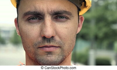 Portrait of male industrial worker wearing helmet looking at camera.