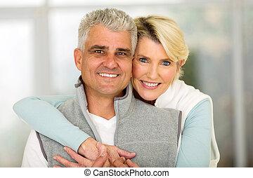 mature couple hugging - close up portrait of mature couple...