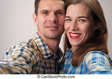 Close-up portrait of middle aged couple