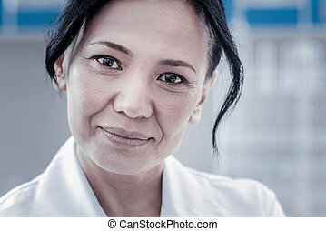 Close up portrait of mindful physician looking into camera
