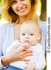 Close up portrait of mother holding baby
