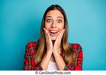 Close-up portrait of nice attractive pretty lovely amazed funny cheerful cheery long-haired girl wearing checked shirt great news reaction isolated on bright vivid shine vibrant blue color background