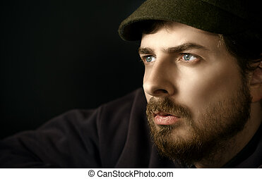 Close-up portrait of pensive man