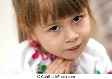 Close-up portrait of pretty little child girl