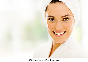 pretty woman with white towel on her head