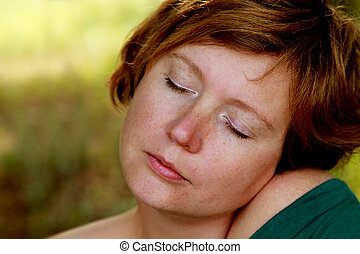 Close up portrait of redheaded woman outdoor
