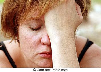 Close up portrait of sad redheaded woman