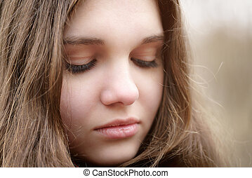 close up portrait of sad young girl