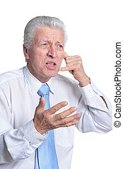 Close up portrait of senior businessman in formal wear...
