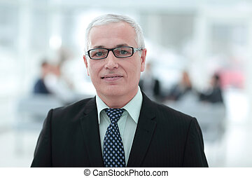 close up portrait of senior businessman in office