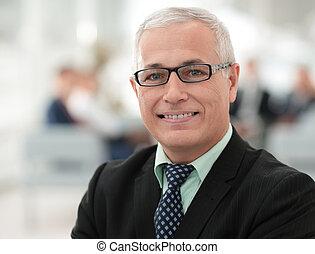close up portrait of senior businessman in office