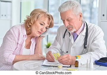 Close up portrait of senior doctor with elderly patient