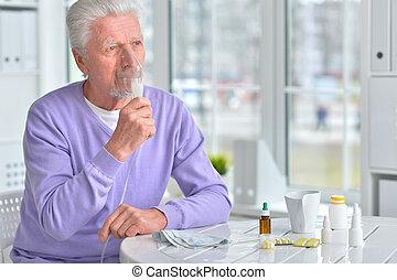 Senior man  with inhaler