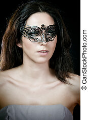 close-up portrait of sexy brunette woman with carnival...