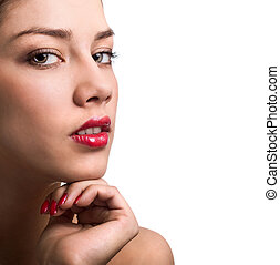 Close-up portrait of sexy caucasian young woman with red bright manicure