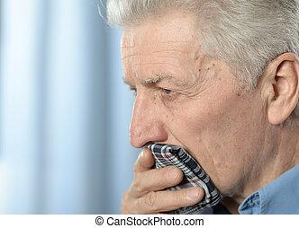 Close up portrait of sad sick senior man