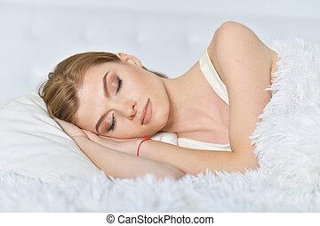 Close up portrait of sleeping beautiful woman