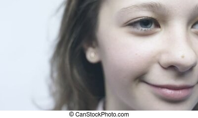 Close-up portrait of smiling girl in slow motion camera.