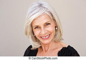 smiling older woman looking happy in black blouse