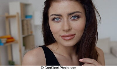 Close up portrait of smiling pretty brunette woman with blue eyes, sensual fresh happy face, positive emotions.