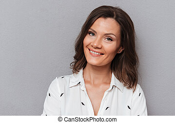 Close up portrait of smiling woman looking at the camera