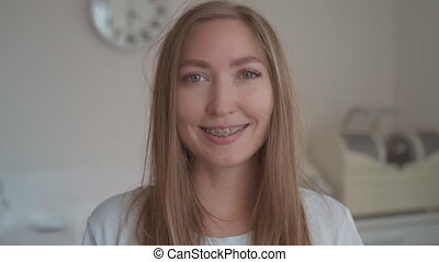 Close up portrait of smiling woman with tooth braces. Happy ...