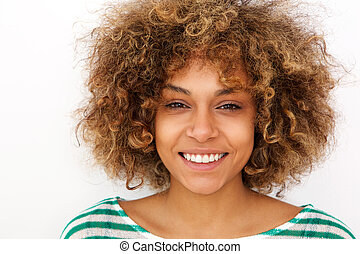 Close up portrait of smiling young african american woman against white background