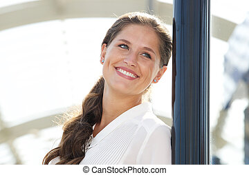 smiling young beautiful woman looking away