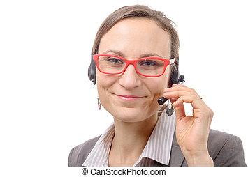 Close-up portrait of smiling young woman with headset