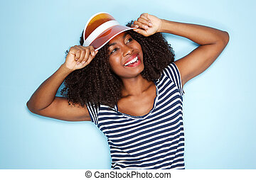 stylish young african american woman in cap over blue background