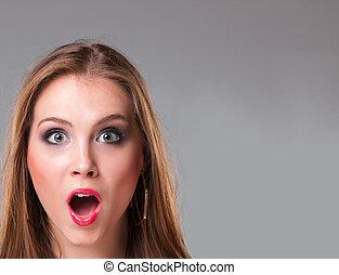 Close-up portrait of surprised beautiful girl