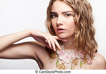 Close-up portrait of teen girl with flower necklace