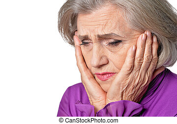 Close up portrait of thoughtful senior woman with headache on white background
