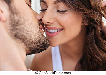 Close-up portrait of two lovers couple kissing