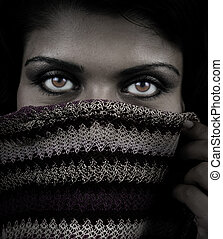 Close up portrait of woman with mystery eyes