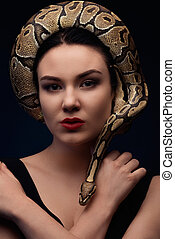 Close up portrait of woman with snake around her head