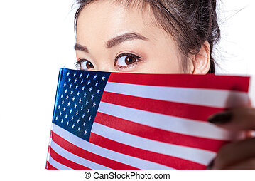 Close-up portrait of young asian woman with american flag looking at camera