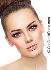 Close-up portrait of young beautiful blue-eyed woman with stylish coral make-up