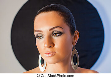 Close-up portrait of young beautiful makeup model