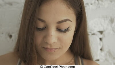 Close-Up Portrait of Young Beautiful Smiling Woman With Long Eyelashes.