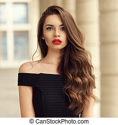 beautiful woman with long brunette curly hair