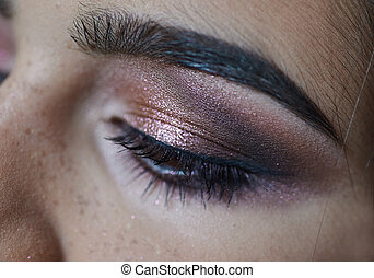 portrait of young beautiful woman's eye zone make up