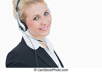 Close-up portrait of young business woman wearing headset
