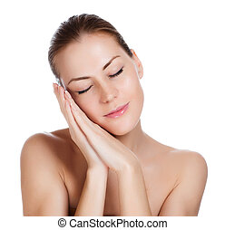 Close-up portrait of young closing eyes woman's face with clean fresh skin - close-up