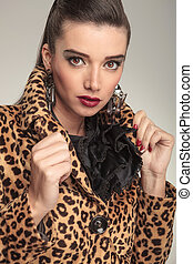 young fashion woman pulling her collar