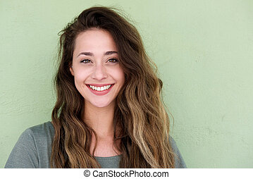 young happy woman on green background